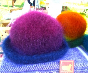Colorful hats made of yarn produced from Old McCaskill's sheep